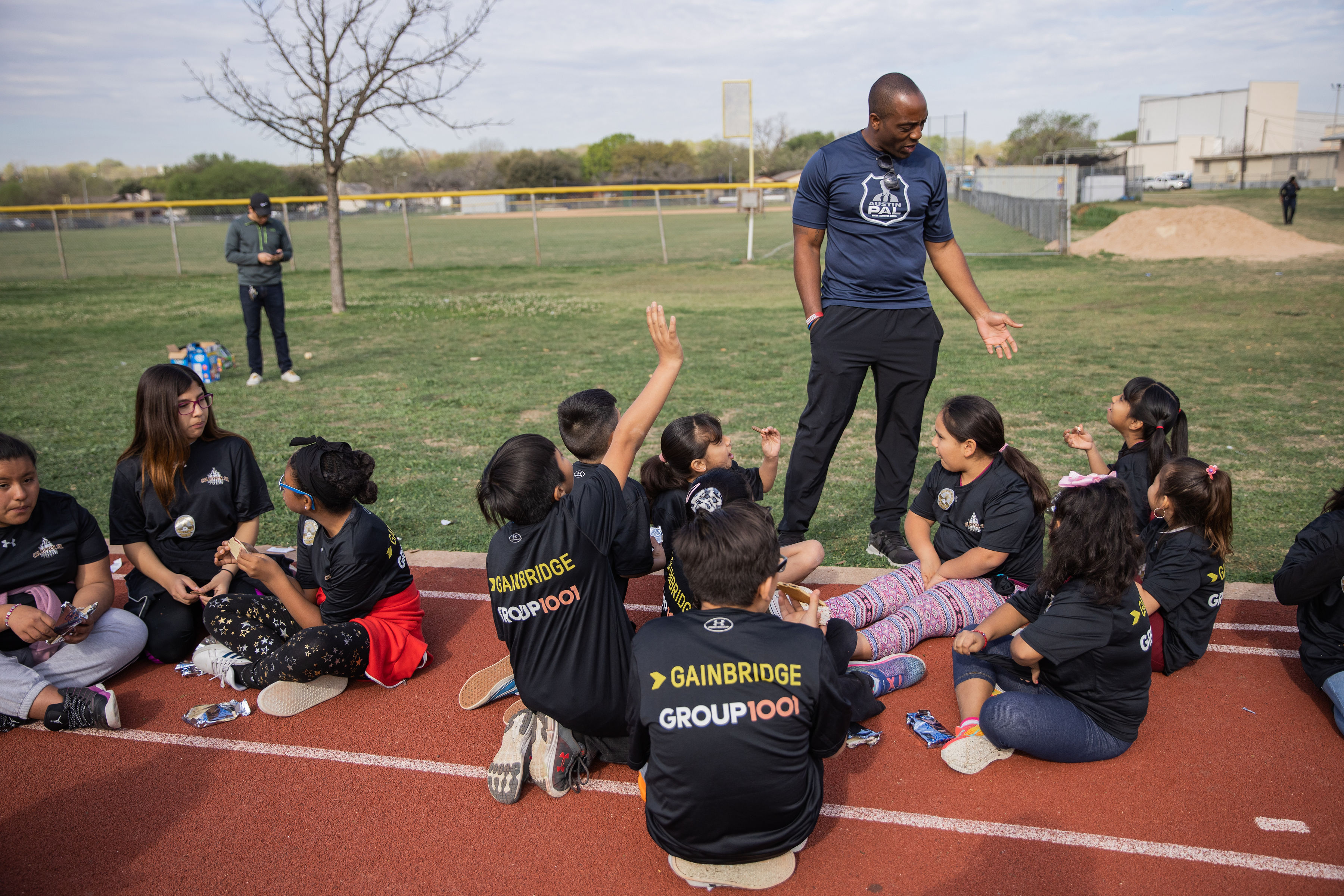 Austin Police Department Officer Jeremy Bohannon with youth at a clinic