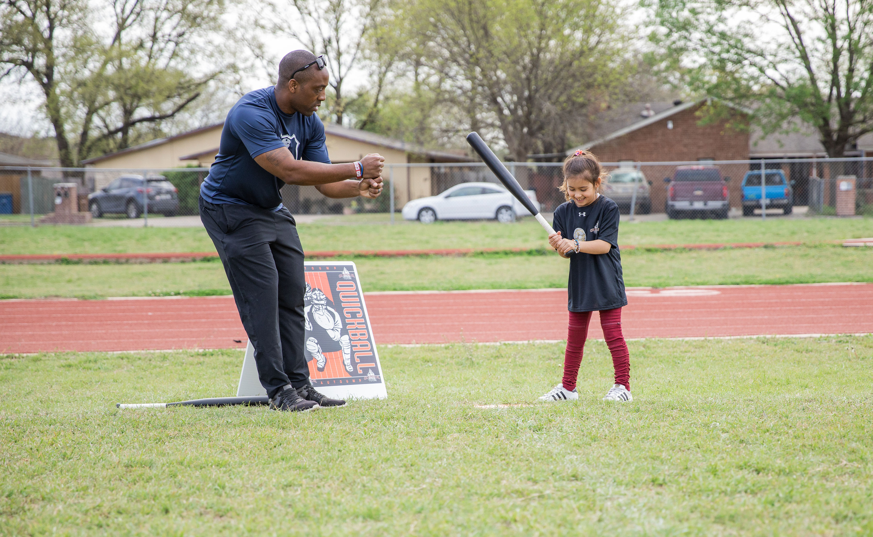 Austin Police Department Officer Jeremy Bohannon with a youth at a clinic