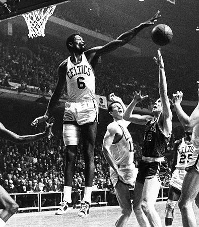 Bill Russell blocking the basketball shot of another player