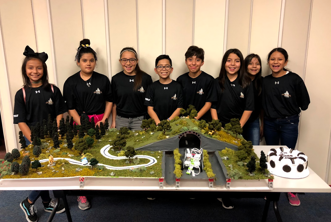 SpringSpirit youth with their winning STEM Competition entry prototype of an ecosystem with a highway running through it.