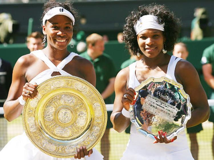 Venus and Serena Williams playing tennis