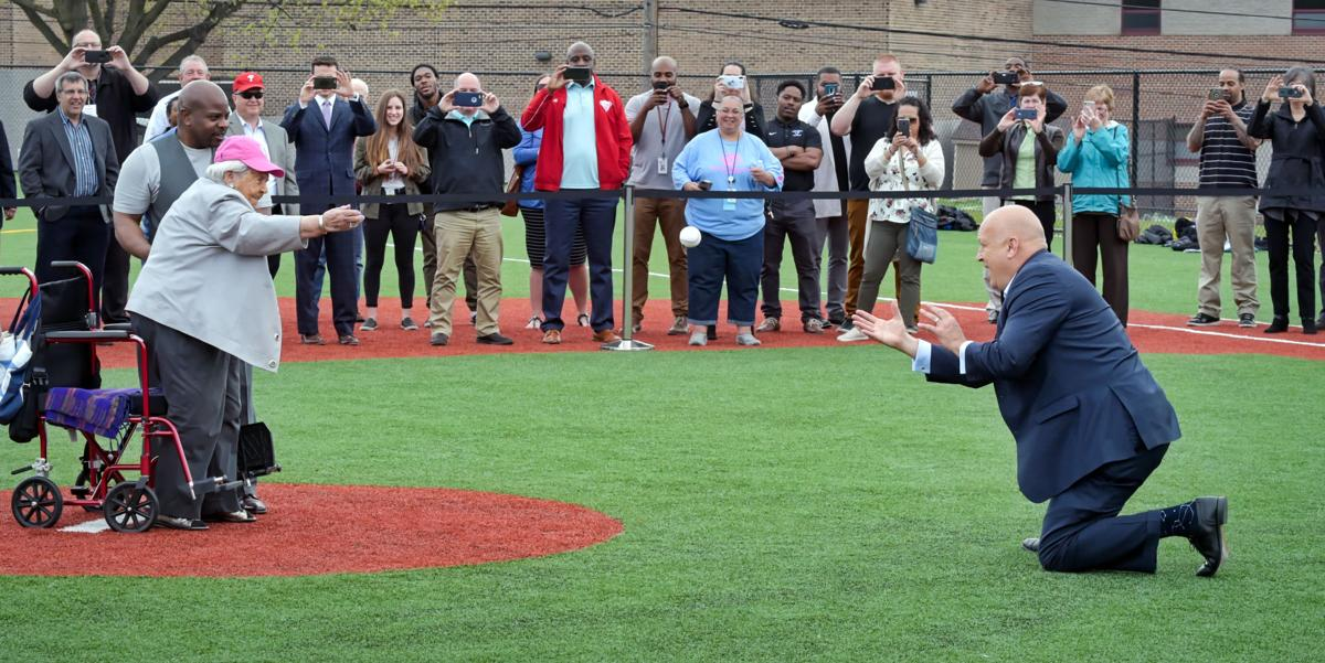 Ann Barshinger pitches ball to Cal Ripken, Jr. on Lancaster Youth Development Park.