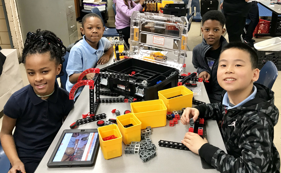 Kids with STEM kits