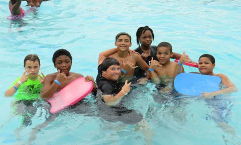 Campers enjoying some time in the pool.