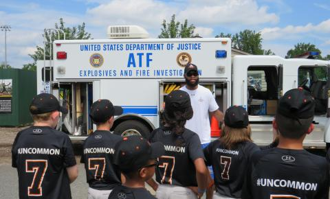 Youth speaking with an officer from ATF.