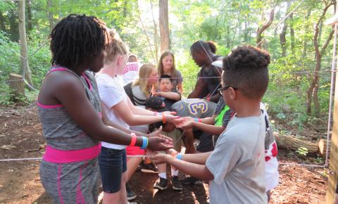 Campers participating in a team building activity.