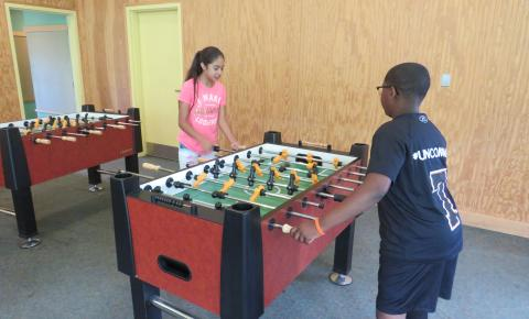 Campers playing Foosball.