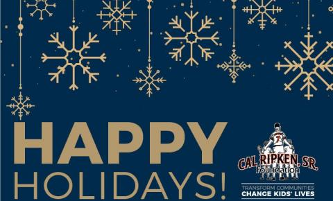 "A picture of our holiday card with gold snowflakes on a blue background with the text ""Happy Holidays"""