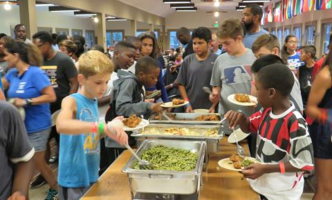 Campers getting a healthy meal.