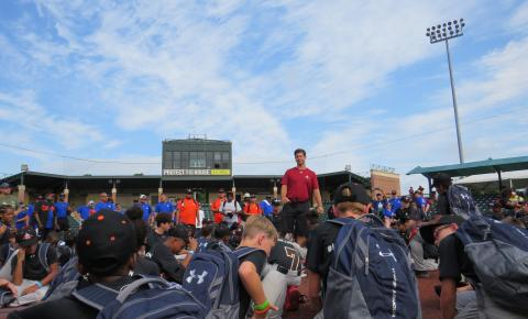 Campers hearing from coach Scott on the field