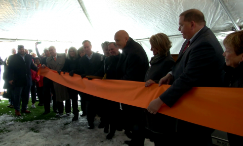 Cal Ripken Jr. cutting the ribbon at a ceremony