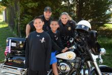 cops with kids on motorcycle